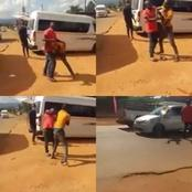 Watch : Taxi Driver Fight Gone Wrong As One Runs Into Traffic & Gets Knocked By A Car.