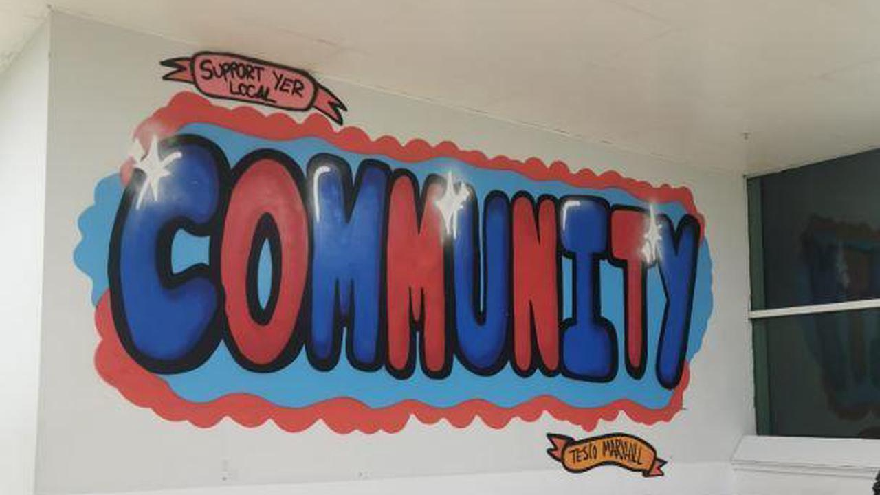 'Community' mural created by North Glasgow youngster unveiled