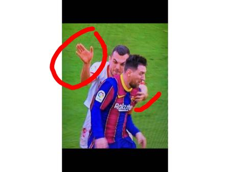 Checkout This Funny photo of a defender trying to slap Messi