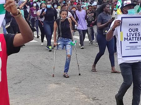 Over N4million raised by protesters for the lady who uses crutches in Abuja protest.