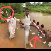 Pastor Onyeze Jesus sprays money on his members during a spiritual bath in a river in Anambra State