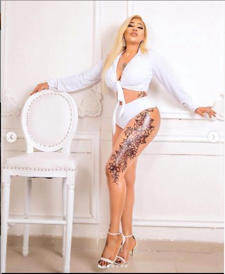Toyin Lawani flaunts her massive tattoo in revealing photos