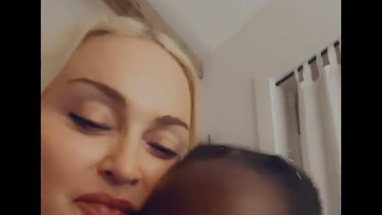 Madonna tells her eight-year-old daughter Estere she loves her 'to the moon and back'... before showing off her dazzling 'Mum' necklace