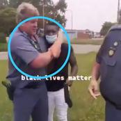 A white police officer was caught strangling a black man and threatening him with a gun daylight