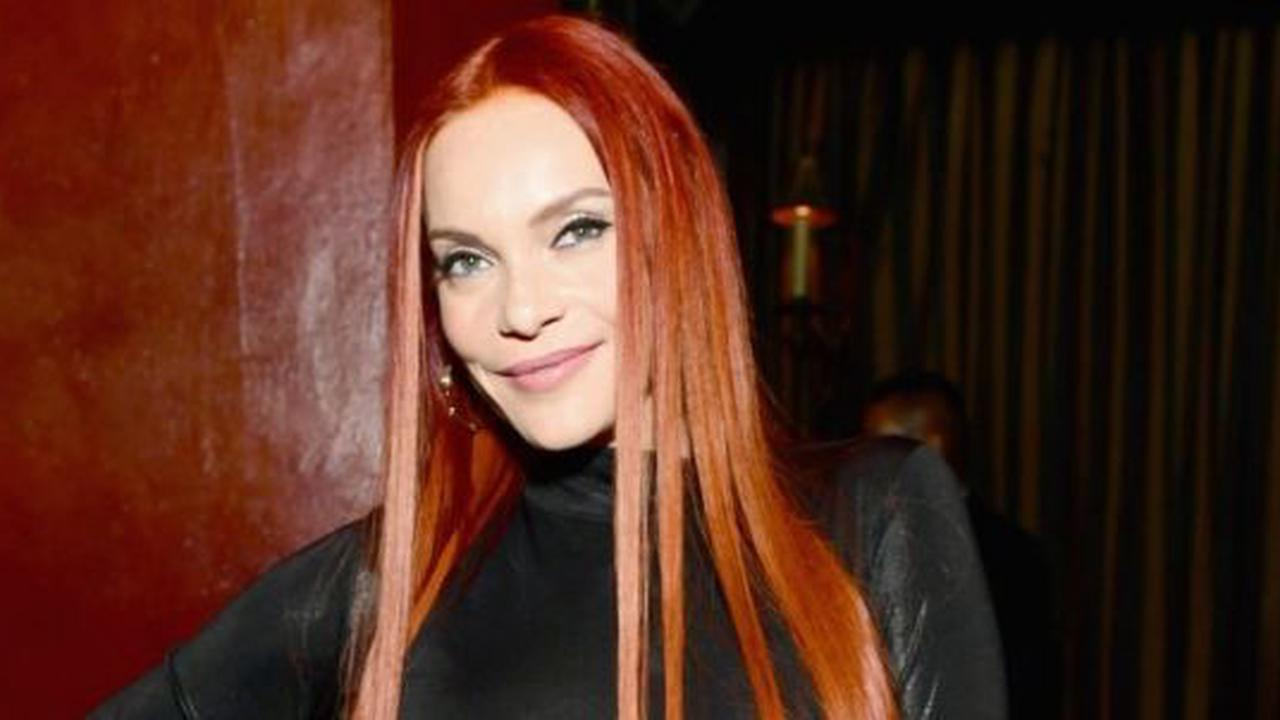 Carmit Bachar Wows In Plunge Dress With Thigh-High Slit, Bombshell Beauty 'Still Ridin The Holiday Vibe'