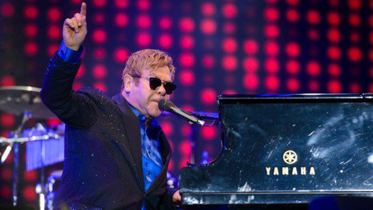 Sir Elton John 'in considerable pain' after fall as he's forced to postpone tour
