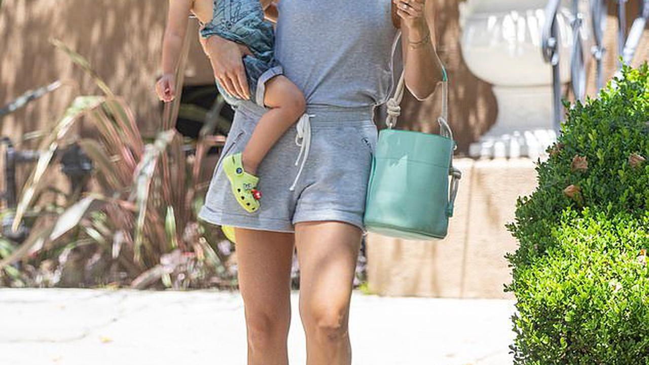 Amanda Kloots wears a trucker hat with son Elvis' name on it as she takes him for a playdate in LA... after clapping back at critics for dating again
