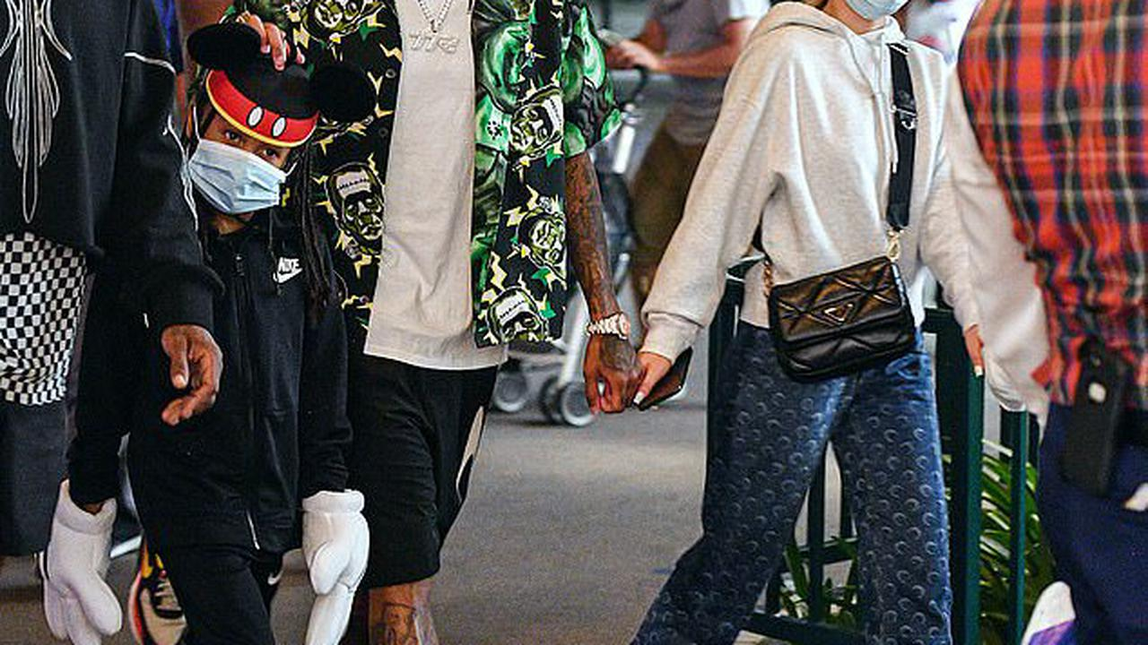 Tyga holds hands with girlfriend Camaryn Swanson as they enjoy a day at Disneyland alongside Amber Rose and their kids