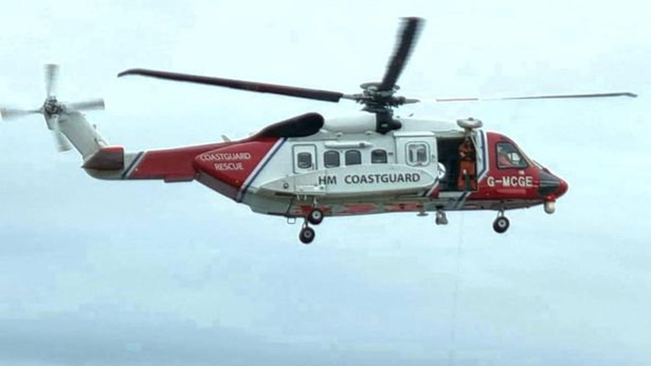Woman airlifted to hospital with suspected broken leg after falling on the beach