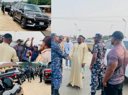 Zubby Micheal Gives Street Boys Bundle Of Cash As He Travels With Luxurious Cars & Police Escorts