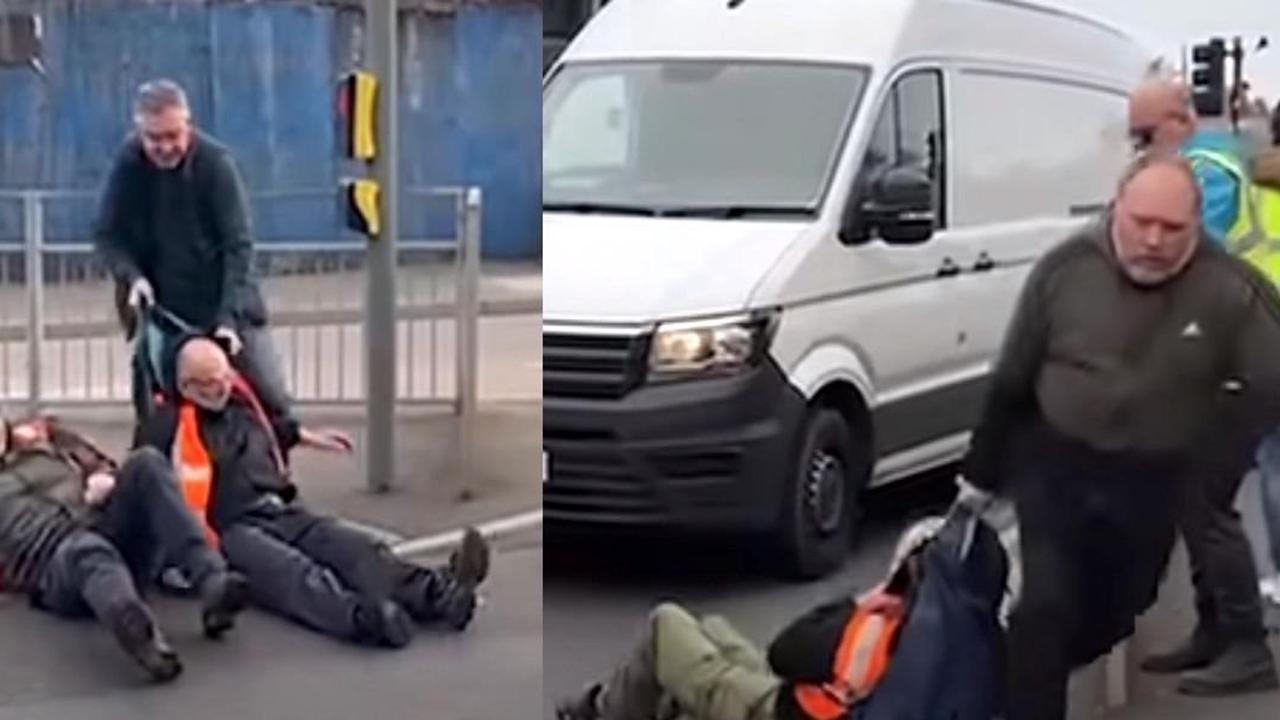 Left-wing activists blocking traffic in protest get dragged away by furious drivers: 'bunch of f***ing arseholes'