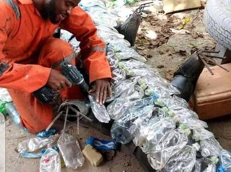 Talented Nigerian Uses Empty Plastic Bottles To Make A Big Crocodile (Photos)