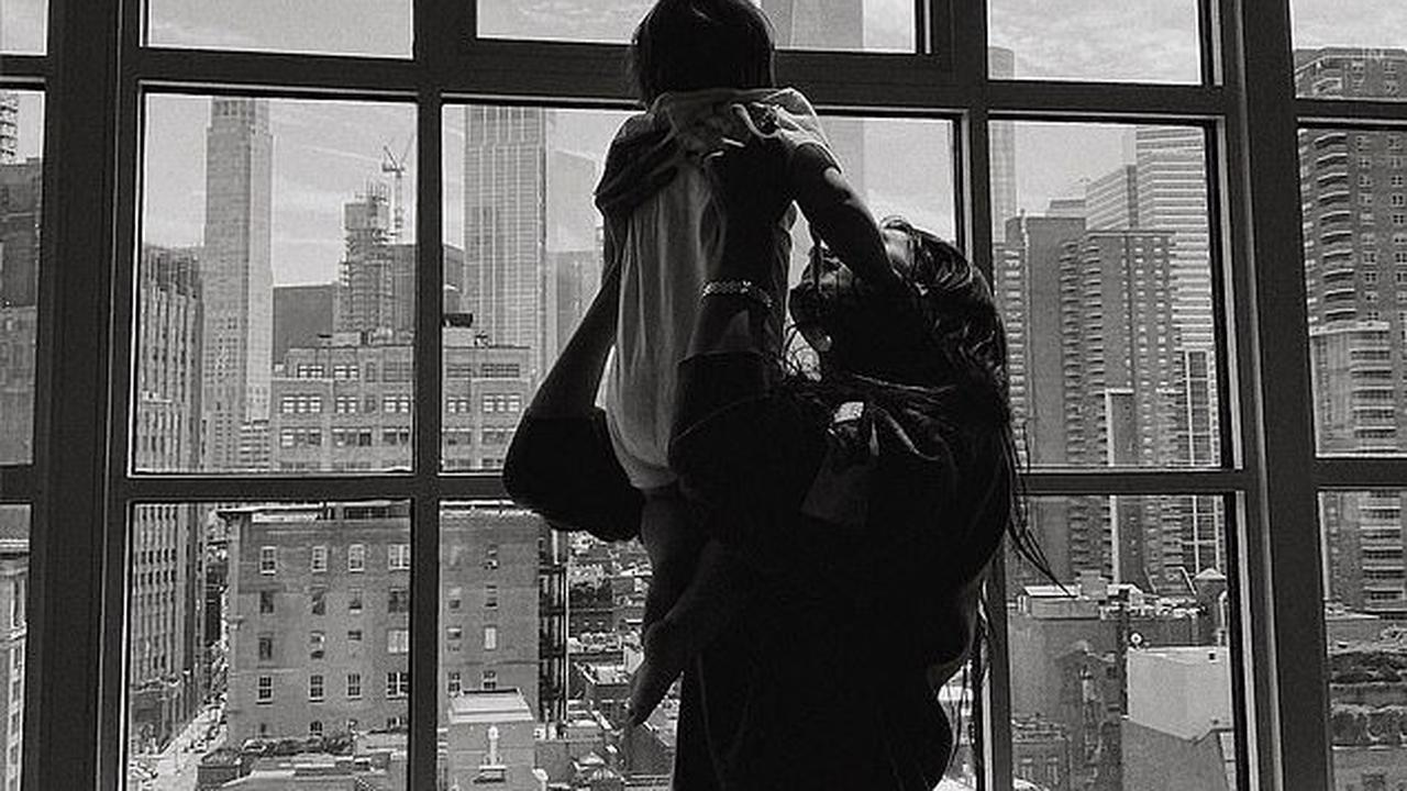 Gigi Hadid shares breathtaking black and white snap of supermodel sister Bella lifting daughter Khai in front of a window overlooking NYC