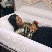 Check people's reactions as a Lady poses in a coffin