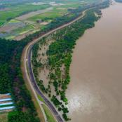 How dike facing turbulent water flow alongside Yangtze River in Wuhan successfully
