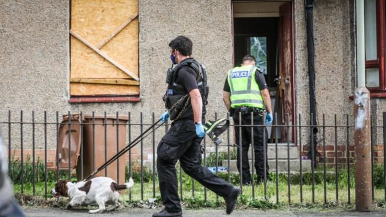 Riot police in morning raid at Dundee house