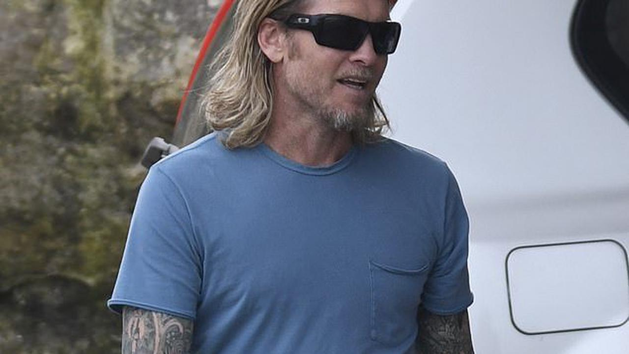 Is that you Sam? Avatar star Worthington looks worlds away from his former self with long hair and tattooed sleeves on set of his new Stan film Transfusion