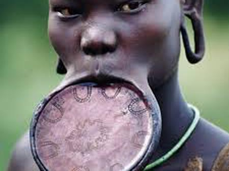 When A Girl Becomes A Teenager In the Surma Tribe She Begins the Process of Lip Stretching.