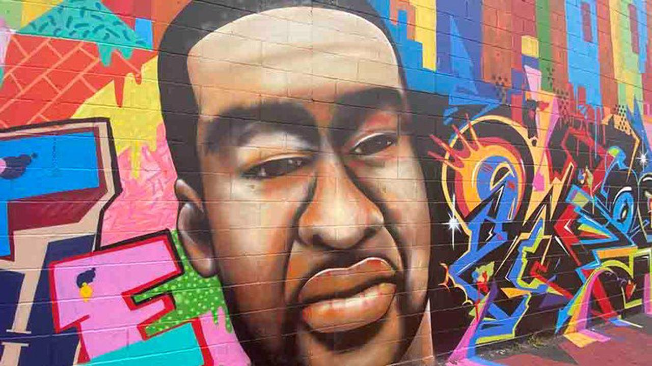 Racist graffiti on George Floyd mural quickly covered up in downtown Houston