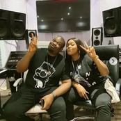 Fans react as Don Jazzy shares photos of himself and a female friend in a pouting competition