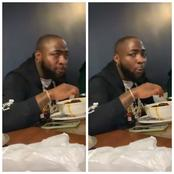 Pictures Of Davido Caught On Camera Eating With His Hand