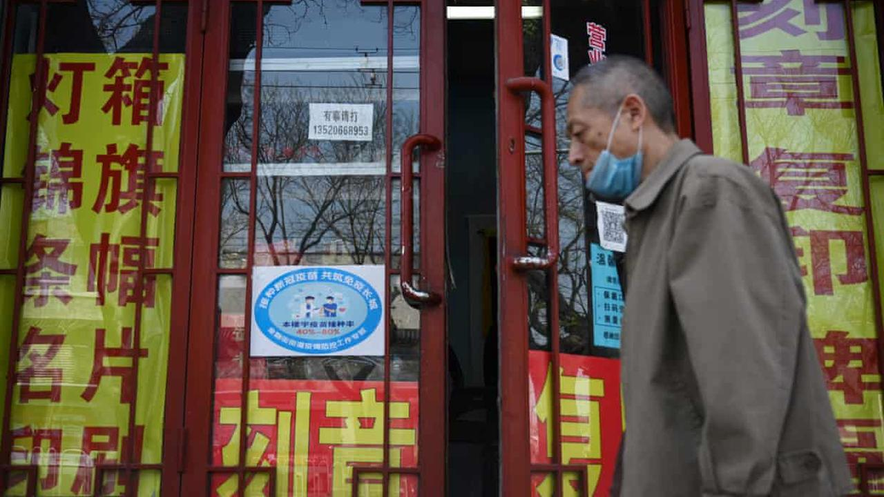 Beijing colour-codes buildings to show workers' Covid vaccination rates