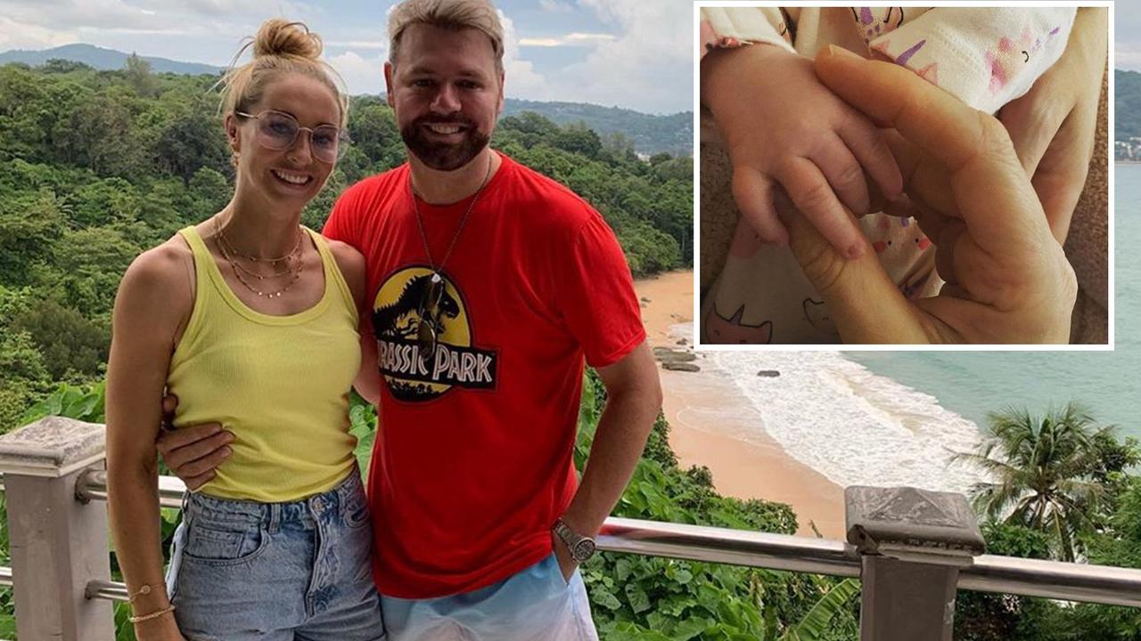 Brian McFadden shares first snap of newborn daughter with fiancee Danielle as they sweetly hold hands