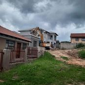 Watch:Businessman demolishes girlfriend's house after they broke up!