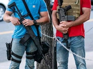 Check Out Photos Of Americans With Guns Guarding Their Stores Amidst Ongoing Protests