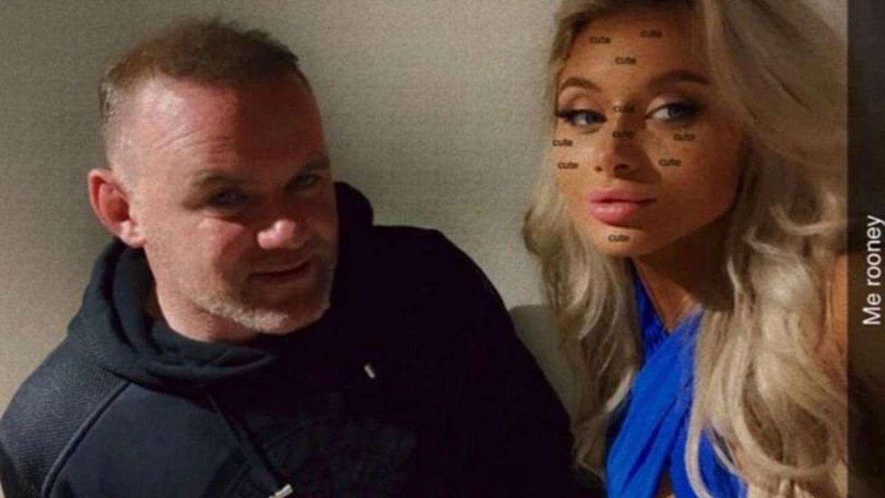 Wayne Rooney filmed walking with two blondes before photos taken of him asleep