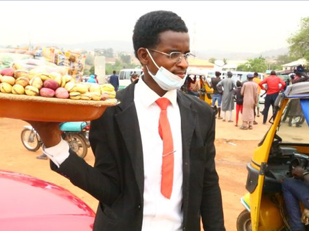 Check Out The Young Man Who Goes Hawking In Suit.