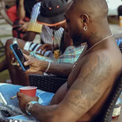 Checkout The Tattoo On Davido's Back, And The Meaning Of What He Wrote On His Back.