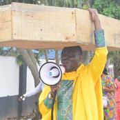 Pastor Carries Coffin In A Protest Against Buhari Govt'. Read What He Said Against The President