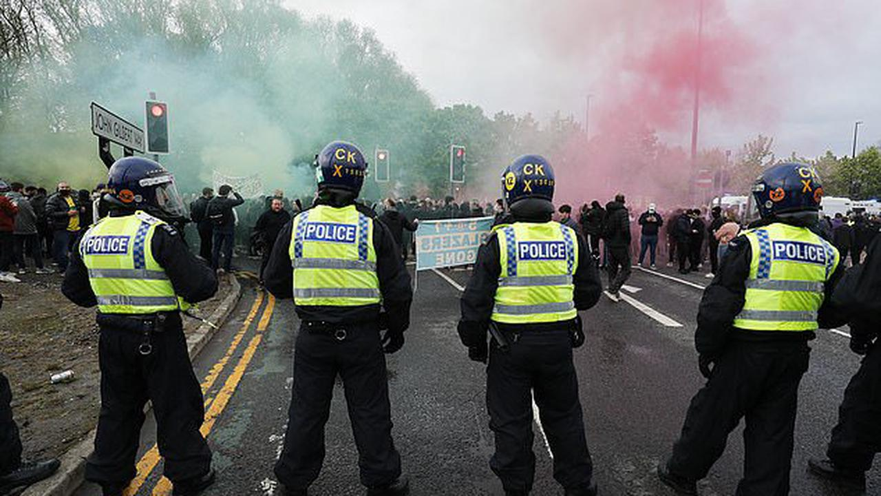 Ten riot vans, a battalion of officers AND a mob of angry protesters... Mayhem in Manchester Part II prior to United's 4-2 defeat by bitter rivals Liverpool