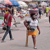 Ghanaians Reacts As A Disabled Woman Carries Water On Her Head To Sell