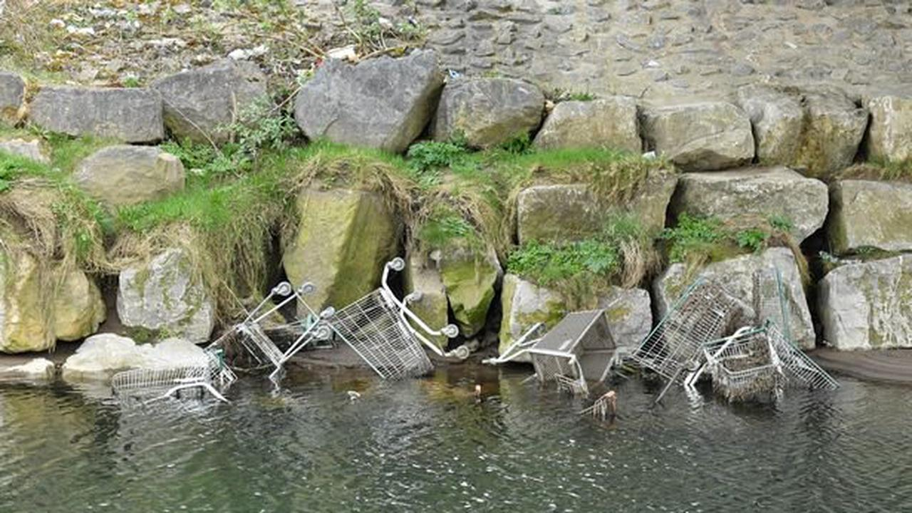 Youths caught dumping trolleys into river where loads were removed last week