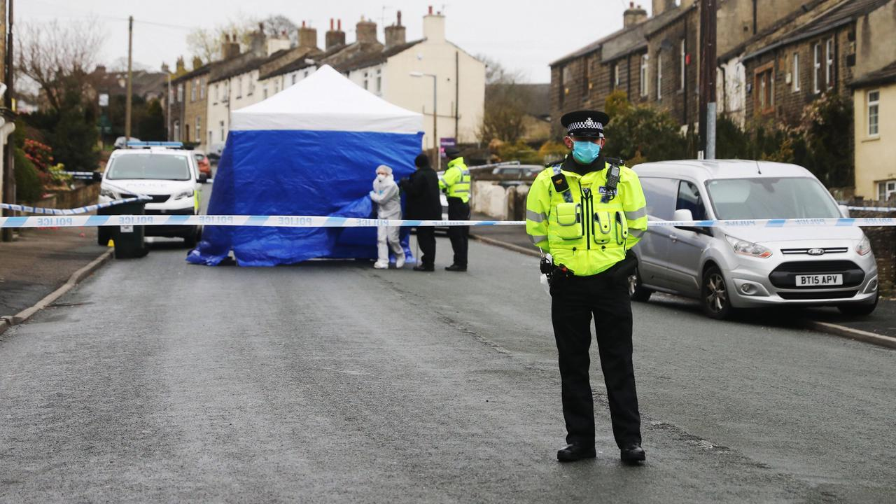Man in his 40s dies after he was found injured at home as woman and 2 men held