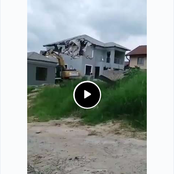 A businessman hired a TLB to demolish the house he built for his girlfriend when they broke up.