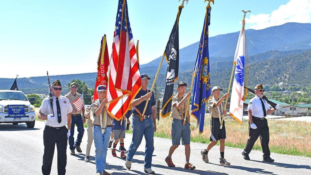 THE VETERANS PRESENTED THE COLORS