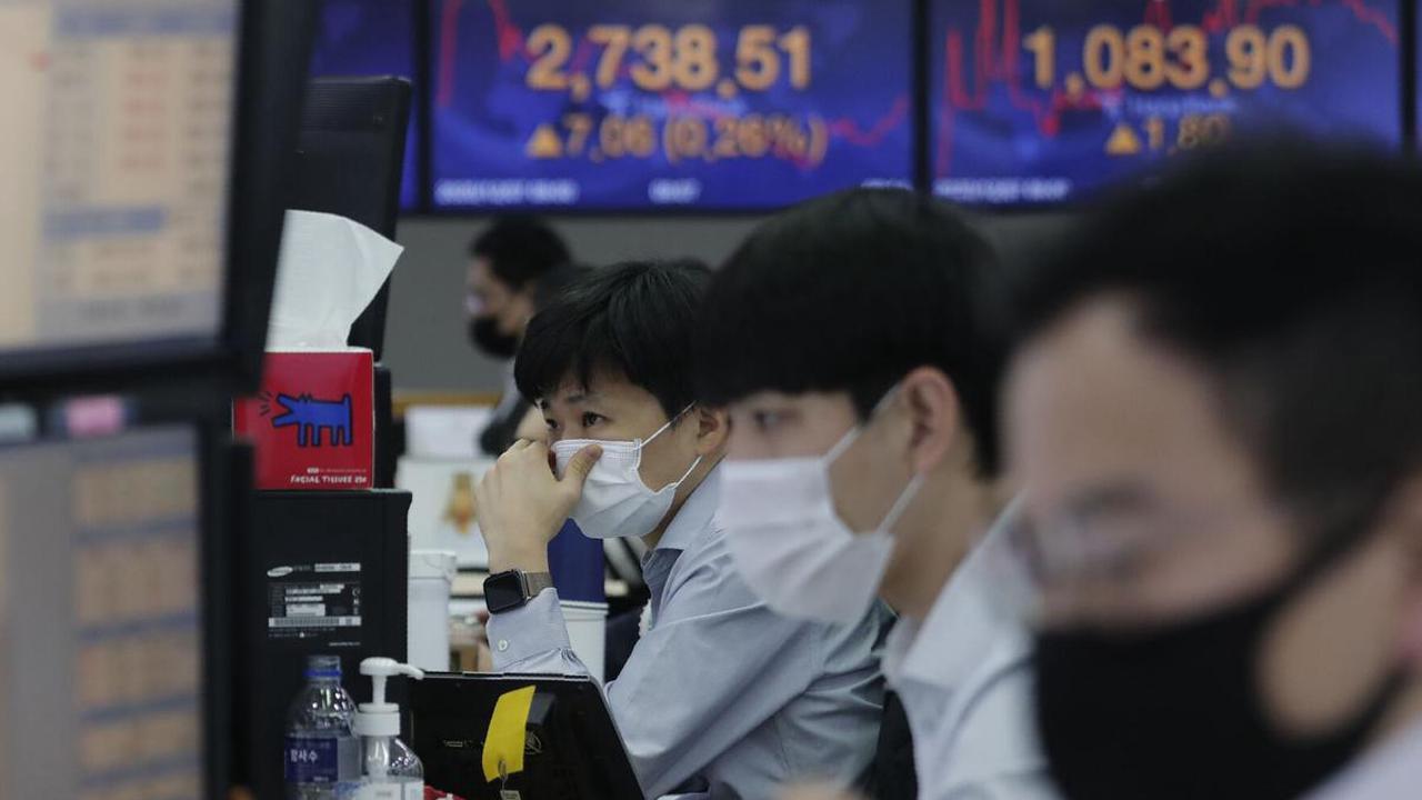 World shares mixed as investors eye vaccines, China-US woes
